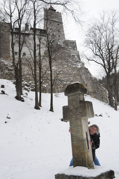 Hiding behind the headstone at Dracula's Castle